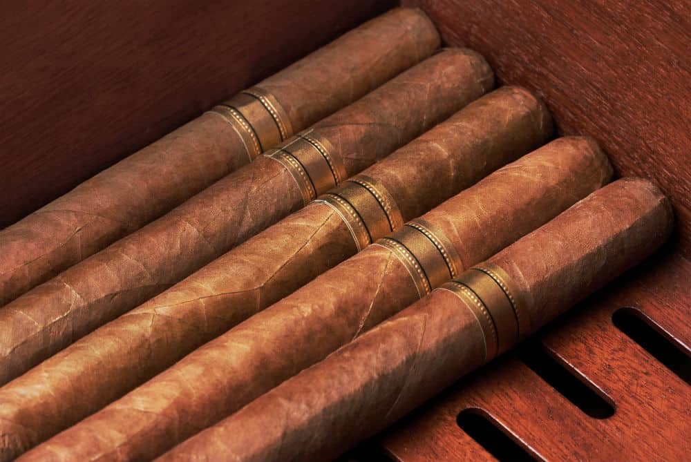 How long does it take a cigar kept at 65-70% RH to dry out when transferred to a less humid area?