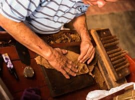 man producing cigars
