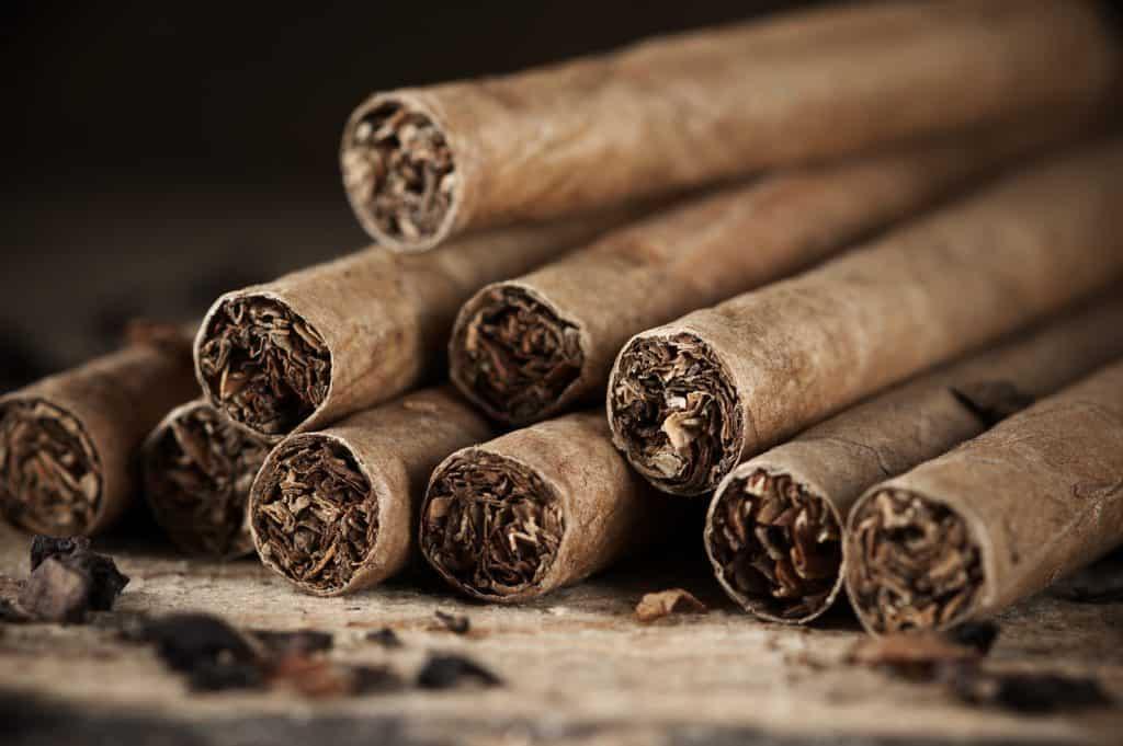 Cigars pile on wood