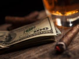 dollars, whiskey and a cigar