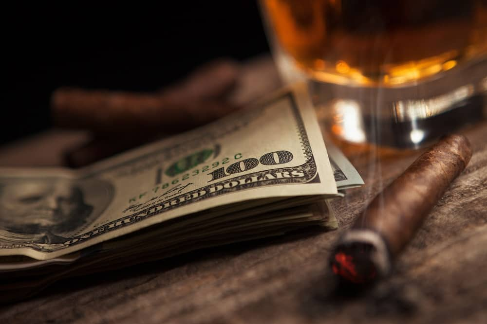 dollars, whiskey and a cigar