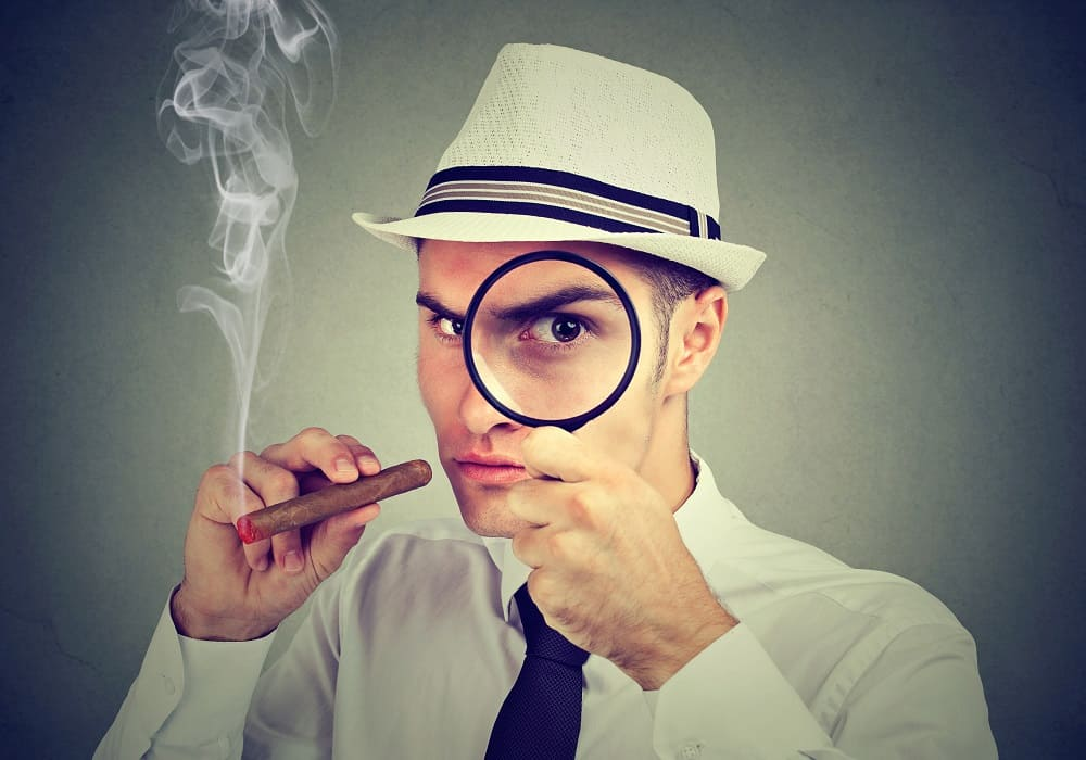 investigator looking at a cigar