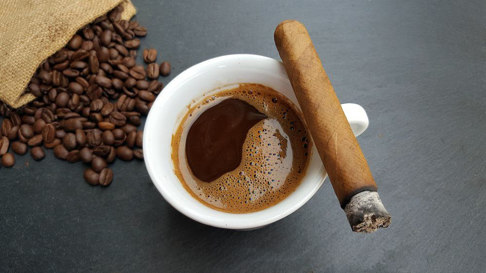 Coffee cup, beans and a cigar