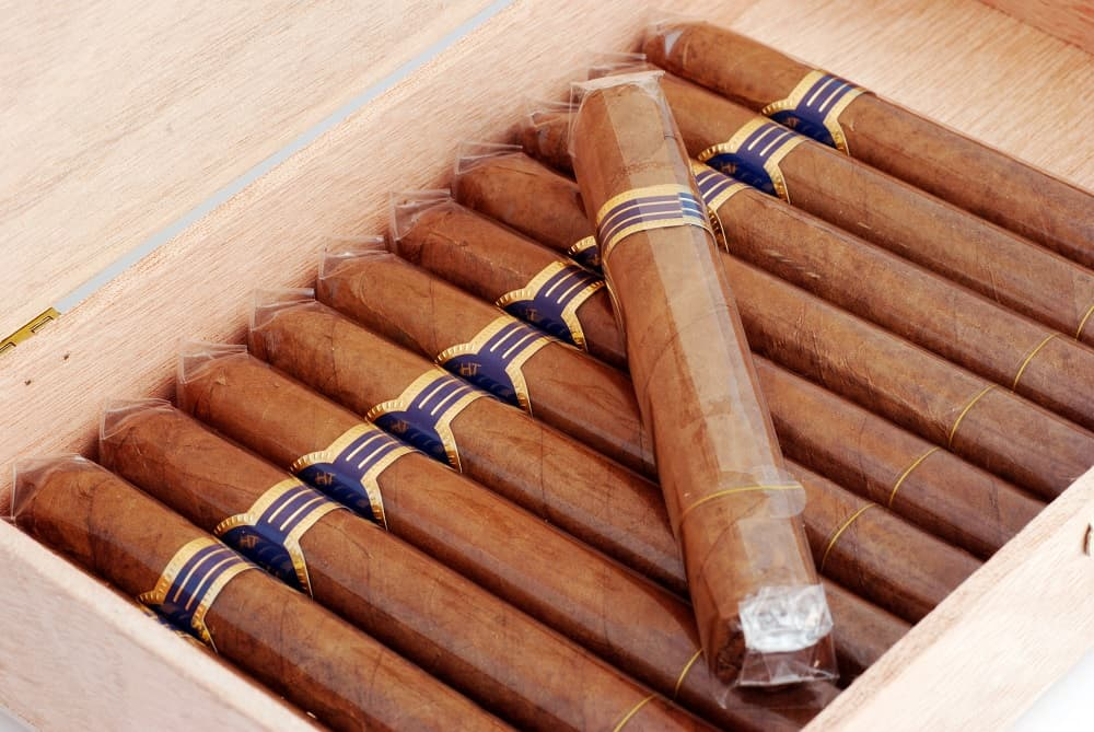 Cigars in a humidor wrapped in cellophane