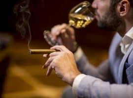 young man tasting cigars